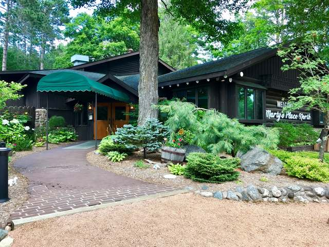 """Here's an amazing opportunity to own a classy dining establishment in the Northwoods. Marty's Place North has over 35 years as a successful supper club with a long tradition of loyal patrons. The property features an incredible decor with nostalgic log beams, a large gas fieldstone fireplace and the """"round room"""" gazebo, which is Marty's pride and joy, serving as the central focus of the restaurant. Additionally, the property offers a lower level banquet room and bar for large parties seating up to 40 people. This room features a mixture of fieldstone and vertical pine in addition to a mounted rustic wine cask, giving it even more Northwood's charm. Marty's is located directly off Hwy 51 north of Minocqua and has great highway visibility. The restaurant includes a state of the art commercial kitchen that has had many new updates. There are also two additional homes that can serve as extra rental income, so start making Old Fashions as an owner of this landmark restaurant today!"""