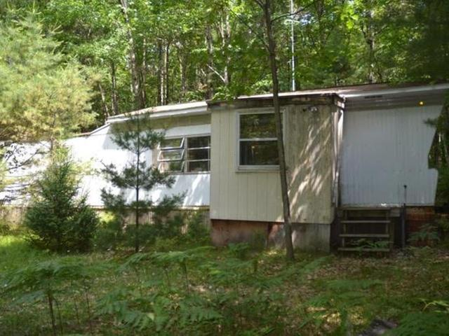 Looking for an affordable property in the Northwoods? This two bedroom, one bath mobile home could be the one for you! The home sits on 1.49 acres of nicely wooded land, creating a private setting. BONUS: This property enjoys a deeded access path to 377 acre Horsehead Lake just down the road. Call today for a showing.