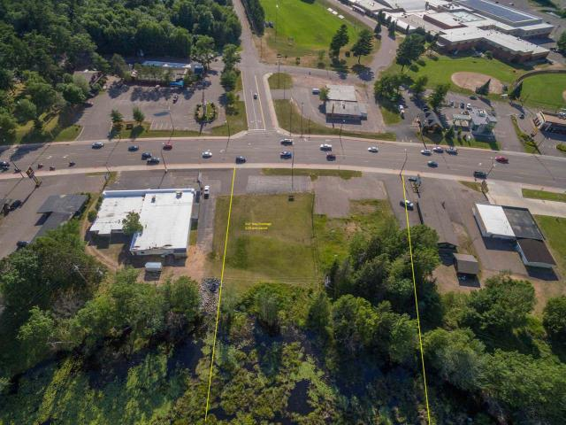 Extemely rare prime Hwy 51 commercial lots 23,000 cars per day traffic count. 212' Hwy frontage 2 direct Hwy 51 access points. Perfect for retail, restaurant, or strip mall approximately 1 acre building site. Walking distance from the Lakeland High School. Great Exposure Plenty of room for parking! Adjacent to Hwy 51 and Hwy 70 intersection.