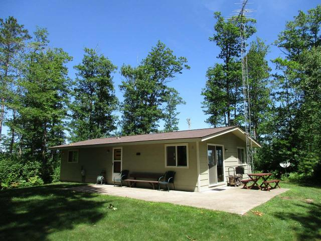 Rare Offering on Clear Lake of the Manitowish Chain of Lakes. End of the road privacy is found at this 2BR, 1BA cabin with 2+ car detached garage. This property offers 326 +/- feet of perfect frontage as well as 2.95+/- acres of well wooded Northern Wisconsin Solitude. The location of the improvements on this parcel allow for expansion or the construction of a larger residence - there is a gorgeous building site located adjacent to the cabin. New survey (2018) clearly shows all lines and corners. New conventional septic (2015). The property adjoins 1,000's of acres of the Northern Highland American Legion State forest which ensures the current secludedness will last a lifetime. Whether you're looking for a buildable lot, or property with a solid cabin on the best lake of the Manitowish Chain, you've just found both!