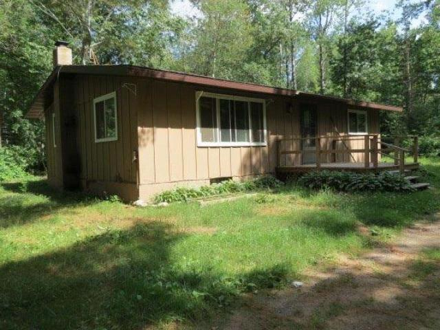 """This two bedroom, one bath home with full basement is tucked into the woods, bordering state land for hunting, on snowmobile trail and close to bike trails and many lakes. This is a good opportunity for a person with some carpenter ability to take advantage of the turn over value of this property. """"Home is being sold in as is condition""""."""