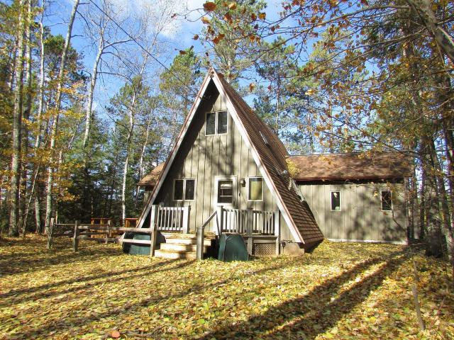 Looking for a place to unwind in total quiet and privacy surrounded by nature? Watch the eagles and sunset while listening to the loons call over historic, slow-no-wake Kasomo lake known for bass and pan fishing. This nicely wooded 3.17-acre lot includes 457-feet of lake frontage with the only neighbors in sight across the lake! Fish from your own pier, dive in to play on the swim raft, or just relax by the fire pit or large deck. This 2 bedroom, 1 bath, 3-season cabin has lots of north woods charm with a knotty pine interior & many recent updates including new a new roof and decks in 2017. Seemingly away from it all, but close to possibly the quaintest town in the northwoods, St. Germain and all it has to offer including many full recreational lakes with public landings, hiking, biking, ATV & snowmobile trails, golfing, shops/fleas markets & fine dining. This is a must see for nature lovers!