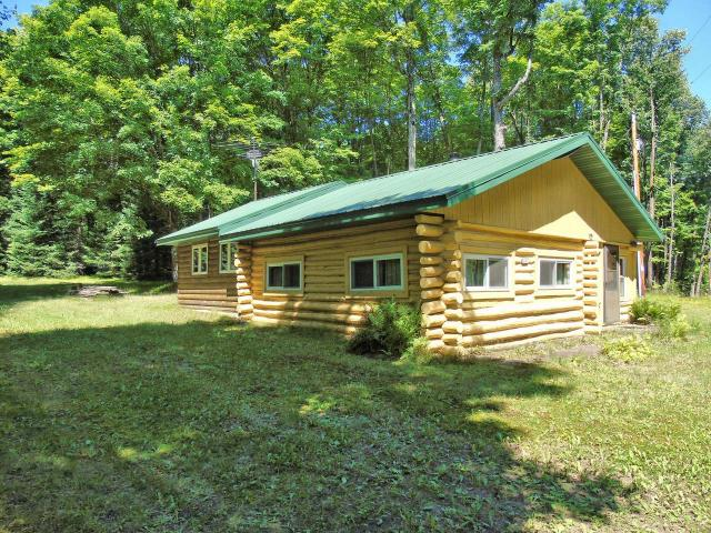 Charming 3BR, 1BA log cabin with great room addition just a short distance to Squaw Lake boat landing! Two small sheds behind the cabin provides space for extra storage. This cabin is situated on nearly two beautifully wooded acres and is ideal for anyone seeking a Northwood's getaway! Not only are you extremely close to prime fishing, summer recreation and hunting lands- a snowmobile trail runs right past the front door for year-round fun!! The brand new furnace in the back addition heats the entire cabin in the coldest of cold winter days and plumbing is structured for winter use. This cabin is priced to sell so contact us today!!!
