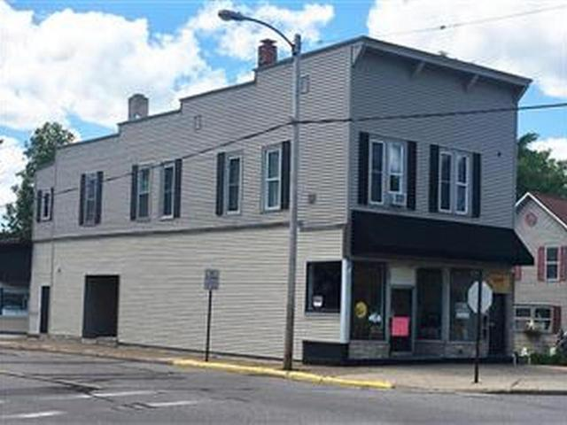 Commercial building in a great location on the corner of Keenan and Kemp Streets. Main level has 2 units for retail or service businesses with separate entrances. Upper level has 2 - 2bed/1bath apartments. Plenty of parking in parking lot and street. All units have been updated. 200 amp service in the large commercial space and 100 amp service in the other 3 units. New flooring, insulation, electric, updated bathrooms, kitchens, and heating systems. New shutters and custom-made canvas awning. Full basement for additional storage. Open your business and live upstairs. Great rental income.