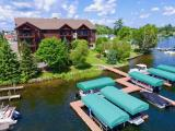 Premiere condo on Lake Minocqua in the highly sought-after Lakeview Condominium. This property is a middle ground-level unit with beautiful landscaping from the patio leading to the water. From there you'll see gorgeous lake views looking South & rippling sand frontage that's perfect for entertaining friends & family. This unit is being sold with a DEEDED DOCK SLIP on the lake, 3 parking slips in the heated underground garage & an additional storage locker. The interior is very high-end & features a chef's kitchen with solid surface countertops and hardwood floors. The unit also provides a spacious lakeside master ensuite, 2 add'l BRs with a guest bath, laundry room & a patio all on one level. Walk out the patio door & jump right onto your boat to cruise the Minocqua Chain. This property is located downtown Minocqua within walking distance to many restaurants & bars. It's also the center of activity for all the events that happen annually in the town of Minocqua. Come see it today.