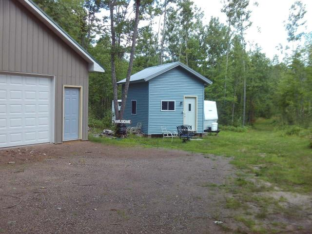 6 acre parcel with newer pole building which has a concrete floor. Plus there are 2 additional storage sheds. Underground electric, with driveway and multiple building sites ready for your new home in the middle of Squirrel, Booth, Diamond and Buckskin Lakes. Camper on property is negotiable. Property is zoned Rural Residential which offers the opportunity to have a hobby farm.
