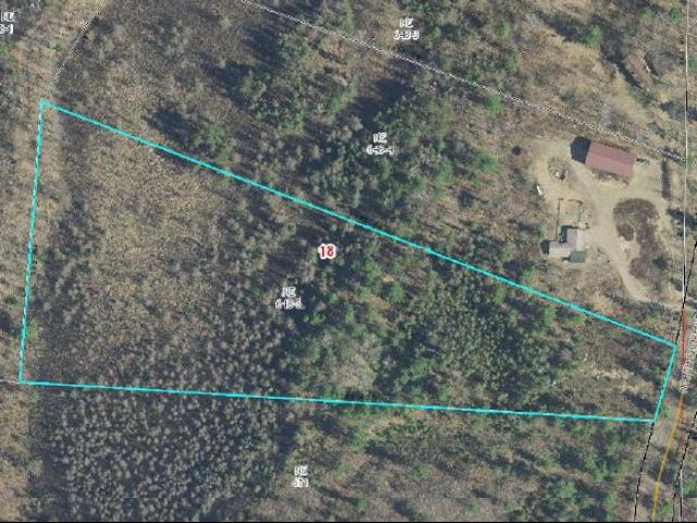 7.9 Acres of complete privacy just outside of town. This parcel offers a lot of land character with mature trees and multiple building sites. Thinking of building a Northwoods getaway? This is the spot!