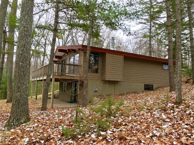 """Beautiful home that has been fully updated preserving the """"Northwoods Charm"""". This 3 BR, 2 BA home is situated in one of the most sought after locations on Lake Tomahawk on the Minocqua Chain of Lakes. Private location but still close enough to ride bikes into town. On the main level you will find 2 BR, full BA, updated kitchen w/ stainless steel appliances, and lovely living room with stacked stone gas FP. There are floor to ceiling windows throughout which make it feel like you're in a tree house. Come outside to enjoy the wrap-around lakeside deck which is great for hosting your guests. On the lower level you will find a walk-out basement w/ gentle slope down to lake. There is the 3rd BR which needs to be finished, spacious family room, another full BA, as well as laundry/utility room. There is a 2 car detached garage steps from the house. The exterior has updated landscaping w/ large stone steps and pavers. Lake Tomahawk properties go fast, don't miss this great opportunity!"""