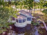 Ever dream of fishing from your living room window? Now is your chance with this two bedroom two bath condo perched over the shoreline of Deer Lake, on the Three Lakes Chain. In 2017 this condo was pampered with a new roof, new carpet and new exterior stain and interior paint. This condo is turn key ready whether you are looking for a place to enjoy of your own or looking for a rental investment. With large bedrooms, an open concept dining and living area, a wood burning stove and wall to wall windows for endless views it will sure please anyone. This is a must see to understand it's true beauty.