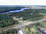 Fantastic commercial location on Highway 51 in Arbor Vitae, WI. This 15-acre property is Zoned ALL PURPOSE and has 1000' of road frontage. Great uses would be for storage buildings or strip mall or both! This property comes with a small 1BR, 1BTH year-round house, and Large detached garage/shed. In addition, there are two 6 inch drill wells on the property along with a large commercial size septic system. Come see this opportunity today!