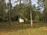 Looking for a place to store all your toys, and don't have room to build a garage on your current property? Here is a great option for you to consider. This 1.4 acre lot has a 1 plus car garage already on the lot. There is a mound septic system, point driven well and natural gas meter already on the property; which was connected to a home that is no longer on the property. So whether you're looking to build a new home or cabin on a nice lot in the Northwoods, or looking for an opportunity to have a second property to store your belongings at this is a great option for you to consider. Located north of Rhinelander off of Hwy 47 close to the McNaughton Pub.