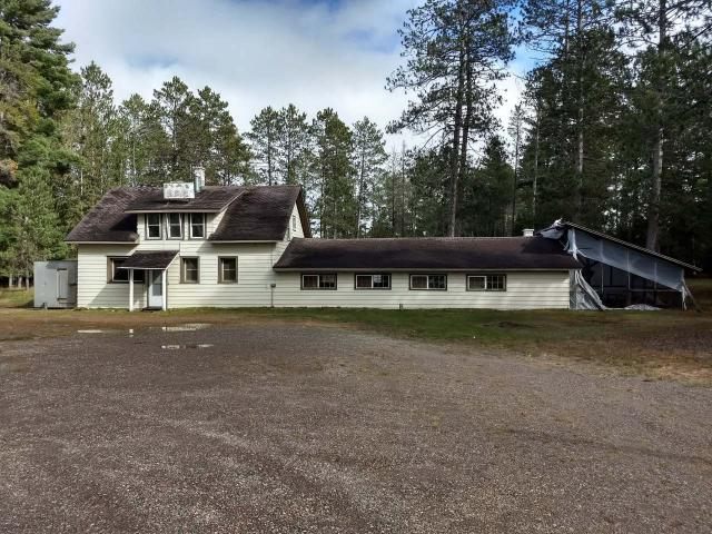 RARE BUSINESS OPPORTUNITY!!! This property can make your Northwoods business dreams become reality. With the over 800 feet of frontage on the Brule River, a world-class trout fishing destination, and 10 acres, this property has a lot business potential. It has a 2,355 sq ft bar with kitchen and restaurant seating with 3 bedroom/ 1 bathroom living quarters on the second floor. There is 20 plus seating in the bar area and 60 plus seating in the dining room. It comes with the oldest continuous liquor license in Wisconsin. There is also a unfinished 2,242 unfinished house with 3-car attached garage on the property with septic and drilled well waiting to be called a home. It is bound to be an amazing snowmobile destination because the trail goes right by the bar!