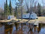 A Waterfront bargain is waiting for you on Chaney Lake just North of the WI state line! Approx 175' level frontage, gorgeous lake view, 2.9 acres, and a 2br/1ba cabin are ready for your family plans! The cabin does need some TLC including floor and foundation work but features a roomy kitchen, wood fireplace, washer/dryer, and a panoramic lake view from the living room. There's also a pier, shed, deck and a level approach to the water. Shopping, ski hills, 100s of lakes, restaurants and all the best the Northwoods has to offer in MI and WI are just minutes away. What's more you're on a large lake known for great fishing as well as peace and quiet. Book a showing today!