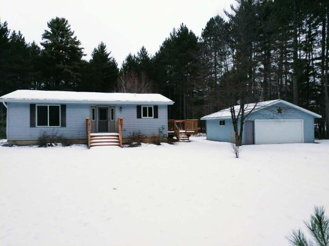 This beautiful, modern and updated home is a great fit for those for a primary or vacation home. Featuring 1.53 acres, this property offers privacy and convenience with Eagle River and Three Lakes just a short drive away. The detached 2-car garage and unfinished basement provide extra storage space. ATV and snowmobilers will be excited to know that both trails are nearby!