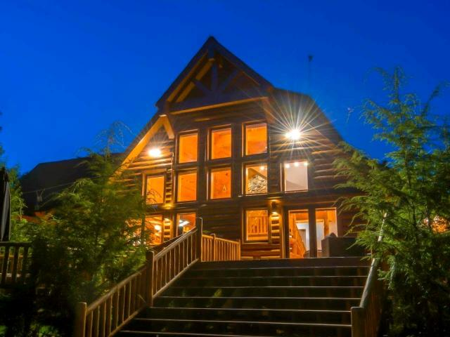 A truly fantastic B&B or VRBO opportunity exists in this architecturally designed energy-efficient log home with contemporary finishes. A soaring 25' ceiling in the great-room greets guests as the enter. Designed for entertaining, the two full kitchens feature professional grade appliances, cherry cabinets, abundant counterspace and elegant guest coffee/wine bar. 6 fireplaces, 4 BR (3 master suites), 5 custom baths, two with 2-person whirlpool tubs. Lower level has a full apartment, office, work-out room & many built-ins. All situated on a professionally landscaped, park-like private 27-acre sanctuary: 2 waterfalls, a pond, 100s of trees, trails & gorgeous perennials. Fly-fish along 1,500' of wild and scenic Black River frontage. Take your pick our outdoor spaces: gazebo, expansive decks, outdoor living room & fire pit. Melt stress away in a custom, yr-round wood-fired sauna cabin. Close to airport, shopping, ski hills, Lake Superior, snowmobile/ATV trails, etc.