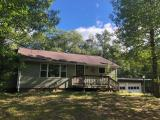 This 2 bedroom 2 full bath Lake home features 17.95 Acres of rolling & level wooded land, 697 feet of frontage on Fetke Lake, & a 36 x 48 ft pole building with concrete floor, power, 2 overhead doors, & bonus overhang for extra storage for your toys. The main floor of this home was finished in 2003 with quality oak kitchen cabinets, brick wood burning fireplace, & patio door leading to the private backyard deck. There are two main floor bedrooms & a full bath with Jacuzzi tub & shower to complete the main floor. The walkout lower level includes a full bathroom, kitchenette, den, laundry area, & space for a large family room. There is a drive under garage & a 2 car attached garage. Updates include new hydronic boiler 2014, vinyl siding, seamless gutters, windows & 3 bedroom septic system. This property is located just north of Rhinelander 5 miles.