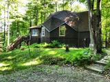 A unique, energy efficient home on Lily Lake. Lily lake is known as a very good fishing lake populated with musky, Walley, Northern Pike, Bass and pan fish. Home features a finished, walk-out lower level. The first floor is an open concept living with a large deck off the living room overlooking the lake. The walls of the main part are 12 inches thick with eight inch walls in other areas of the home making it very energy efficient. Numerous windows, most are triple pane, makes the home quite bright and gives you great views all around. Property is located on the ATV/snowmobile trails and just a short distance from the boat landing. Two hundred seventy eight ft of frontage with a 1.9 acre wooded lot makes this a great vacation home.
