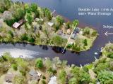 Amazing peninsula property with over 500' of water frontage on both Boulder Lake & the Manitowish River! There you will find a west-facing 1BR, 1BA cottage that has been tastefully remodeled sitting only 10 feet from the lake, and an additional 1BR, 1BA guest cottage with a covered porch on both structures and workshop. The cottage and guest suite can sleep 8 and the dining room also can seat 8 guests.The main cottage boasts an open concept with sliding doors that open up to the water. Outside there is a gorgeous patio and a level yard that's perfect for entertaining friends and family. There is also a 20x24 garage to store vehicles and lake toys. Property also has 2 docks one on the Lake and one on the river.Don't miss this one, call today!