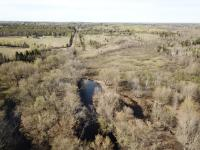 Nature lovers and sportspersons wonderland! Enjoy Me! 1 mile frontage on the Chippewa River, hunting for grouse or ducks on any of the 4 ponds, with 160 acres of towering timberland. 40 private acres with a small rustic cabin, wired for electrical, 40.8 acres in MFL open and 81.82 in closed MFL. 3 tree stands on site, and great potential for ATV Trails. Don't miss out on making this paradise your future!