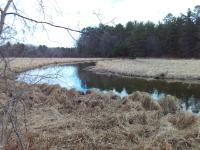 Where do you find privacy and a location close to town? This lot is over 6 acres of wooded land with a gentle slope to hundreds of feet of beautiful meandering frontage on the Tomahawk River. Percolation test for a 3 bedroom home on file.