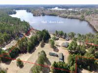 Here's a great opportunity to own a Northwoods Landmark Resort on Half Moon Lake between Tomahawk and Minocqua. The resort features 5 cottages total, 4 of them being year-round. You'll find a newer 2 unit duplex with 2 BR and 1 BA each, both w/ gas FP, cathedral ceilings, and great water views. The other 2 waterfront cabins have been tastefully remodeled each hosting 2 BR, 1 BA. In addition, there is also a 3 BR year-round main home that has been extensively remodeled. The property has 600' of lake frontage and just under 11 acres. Also included is a 3+ car garage/workshop (approx. 900 sq ft), an additional 2 story (approx. 1800 sq ft) workshop w/ concrete floors/drains, and a 3rd garage/outbuilding. The business has great rental income with lots of room for expansion. Close to many bars and restaurants in the area. Adjacent lakefront lot for sale with 17.73 acres. Make your appointment today and view this unique opportunity! New survey to be on file end of May 19'.