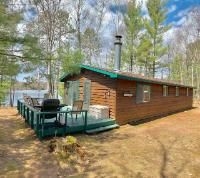 Great cedar sided home on quite Bobidosh Lake. The property has a 1/9 ownership access to 1181 acre White Sand Lake with dock and beautiful boardwalk! This 2 BR, 1 BTH with 23'x23' detached garage has great bones and is ready for summer fun! The home has a new roof and newly installed septic system. The property has 100' of sand frontage with NW exposure offering fantastic sunsets. The access to White Sand Lake is very close with a tranquil stroll through the bog boardwalk and ends on the sandy shore where the shared dock is located. This is a great opportunity to experience both a large full recreation lake and also enjoy the calming quiet of the Northwoods from your Cozy Cabin on a 47-acre clear water lake. Call today!