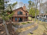 Rare opportunity for a beautiful custom built home on Big Arbor Vitae Lake! This 4 BR 3BA home is over 4,000 square feet with a 38'x12' east facing deck to catch all the morning sun! The main level boasts a beautifully laid out open concept with striking views of the lake, three bedrooms, a fireplace, and a well thought out laundry room. The master bedroom in equipped with a large walk in closet, Jacuzzi and walk-out access to the deck. A custom built chef's kitchen makes this first floor something dreams are made of. The walk-out lower level has two more bedrooms, a second fireplace, oversized storage room, and plumbing installed to build your very own wet bar! And the best part? Take a walk down to your pier and check out the 76 feet of sand frontage on gorgeous Big Arbor Vitae Lake! This home is a must see as no details have been left behind on this immaculately designed property.