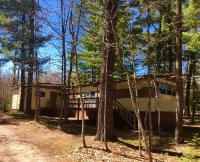 SUGAR CAMP GET-A-WAY - This affordable year-round home is located between Rhinelander and Eagle River in the beautiful Northwoods of Wisconsin! Surrounded by lakes and woods, this property could be your vacation escape, your primary residence, or a great rental property! There are 2 bedrooms and a full bath, a large stick-built addition that can be used in a variety of ways, a spacious living room/kitchen that is open and bright, a partial basement with interior and exterior entrances, and a large sun deck. The flooring is newer, and the kitchen and bathroom have been updated. You are surrounded by ATV and snowmobile trails and yet are close to shopping, dining and all the 4-season recreational fun you crave! This one is a lot of bang for your buck, take a look today!