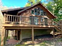 Here is an opportunity to have a year-round low maintenance Tomahawk Log Home with 2x6 construction wrapped with large log siding. This incredible getaway property is located on the Squirrel Lake Island and has immense privacy. You will find old Hemlocks, Cedar and White Pines around the property giving you a true Northwoods feeling as you boat up to your front door. The home is 3 BR, 1 1/2 BTH, lower level cedar sauna, outdoor shower, cathedral ceilings and new Pella lakeside windows and doors along with a 2-year-old 50-year roof. In addition, this property offers N/W facing frontage with beautiful sunsets and 253 ft of sand frontage with deep water drop off, ideal for swimming and boating recreation. The seller also has adjacent lots available to any buyer interested in the property. Don't miss this opportunity to see this one of a kind property!