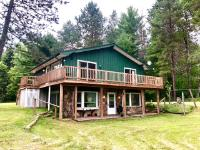 Tremendous opportunity in Minocqua on the Tomahawk River! This upper and lower duplex features beautiful views of the river and two unique fireplaces in the living rooms along with a full kitchen and bath for both. Live in one half and rent out the other! Each half is set up for individual renters. You will love the location and the approach, close to town and shopping. There's also a two-car detached garage for storage. Don't let this one get away, make an appointment today