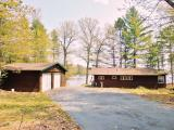Your northwoods getaway just became a reality with this turn-key, adorable 2BR 1BA cabin with 150 feet of perfect sand frontage on pristine Little Spider Lake. This custom built cabin is only 30 feet from the shore with a spacious back patio, interior insulated porch, two car detached garage, storage shed, and a PRIVATE boat launch! The home has been well maintained with a new roof(2013), new siding, new windows, new washer and dryer, a window air-conditioning unit and a lightly used wall furnace. Better yet, most of the furnishings come with this sale! Little Spider Lake is 235 acres with great fishing and recreation but also is also partly surrounded by state land for a quiet, unpopulated feel. It really doesn't get much better than this!