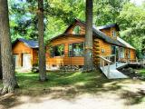 Looking for a secluded, log-sided Northwoods cabin? Look no further, this Found Lake cabin is ready to move into. The spacious, open floor plan will be great for entertaining family or guests. A convenient gas log fireplace highlights the living room. Patio doors lead to a lake side deck with a great view of Found Lake. Everyone will surely enjoy the nearby hot tub & camp fire. The main level features two bedrooms & one and a half baths. An open stairway leads to a loft and another bedroom. The full basement has laundry hookups. There is a two car attached garage plus a detached storage shed for the boat. Found Lake is a 326 acre full recreational lake for you to enjoy. It is conveniently located a short drive from St Germain for your shopping needs.