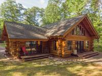 BE CAPTIVATED by this masterfully crafted hand-scribe FULL LOG home with 126' frontage and 1.48 acres on tranquil Stepping Stone Lake #1! An open concept main floor features towering cathedral ceilings, massive log beams, large kitchen with wrap around marble countered bar, cozy living room with a handsome field stone wood burning fireplace, convenient half bath & 1st floor laundry, lavish master bedroom suite with huge master bath & huge walk-in closet, plus a beautiful family room with windows on three sides. A wall of windows gives a picture postcard view of the lake & warms the interior with abundant natural light. Walk the beautifully decorated staircase to find an expansive loft, full bath, & two bedrooms. Lavishly landscaped w/field-stone & flagstone walkways, patio w/fire pit, & 3 decks. Easy access to bike & snowmobile trails are yours plus there's 2 boat landings nearby to access the world famous Manitowish Chain of Lakes to boot! Most furnishings included! Come see today!