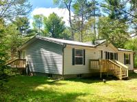 Here you'll find a 3 BR, 2 full BA home nestled away in a quiet area of Plum Lake. Sitting on 1.41 acres of towering pines, there is abundant backyard space for entertaining. Many updates have been done and this home is move-in ready for the next family to enjoy. New metal roof, new septic, new flooring, fresh paint, and all new decks. On the main floor, there is a master BR w/ ensuite, 2 additional BR w/ BA, and main floor laundry. There is an 1100 sq ft unfinished, dry basement that could be converted to another bedroom or rec room. This home currently runs off of the 500 gal owned propane tank but also has natural gas hookups and is easily converted if desired. This home sits in a great location and is a few minutes from Sayner or 10 minute drive to St. Germain where you have endless options for restaurants and bars and snowmobile/ATV trails out the back door. Property backs up to thousands of acres of state forest for that extra buffer of privacy!