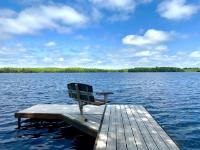 Looking to build your Northwoods dream home with the ultimate Wilderness factor? Look no further, this is a rare find on No Man's Lake. Featuring 4.42 acres of wooded privacy and 400' of level, sand frontage on fully recreational No Man's Lake. As your drive through the gated access you will be welcomed by groves of wild ferns and towering hardwoods which have been beautifully German Forested. There is a driveway present and power at the lot line. No Man's Lake is a privately owned 230 acre Class A fishing lake with excellent water clarity. Vacant lots are hard to come by on this lake and the last lot sold through the MLS was in 2008. Located 15 minutes north of Manitowish Waters, you are just a short drive away to many restaurants, bars, and entertainment.