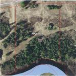 This property features 2.74 acres of partially cleared and wooded land with over 300' of Turtle River Frontage. The property needs a driveway cleared to a nice building spot near the water's edge among the hardwood and evergreen trees. For the outdoor enthusiasts, either kayak, canoe, tube, fish in the water, snowmobile or ATV trails right from the property. There is a public access within this subdivision to launch a boat then travel into Pike Lake via the river.