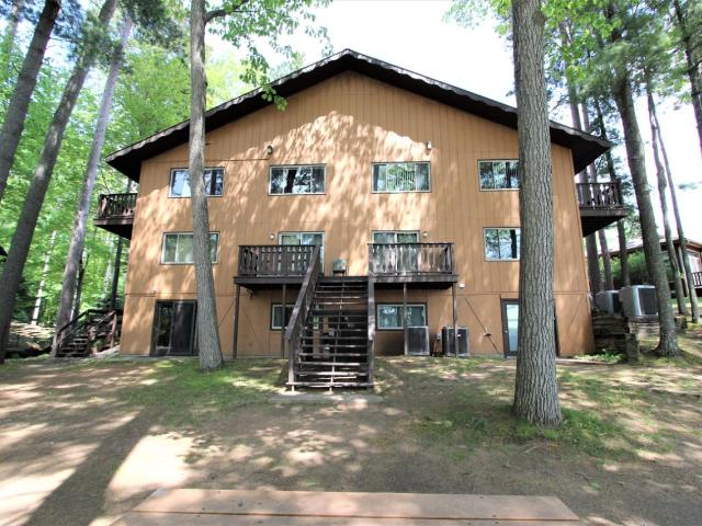 LOCATION, LOCATION, LOCATION!!! This condo located on Minocqua Lake is just a short walk or bike ride down the Bearskin Trail to downtown. This condo offers everything you need to come and enjoy the Northwood's lake life. Level walk out to ripple sand frontage, your own deeded boat slip, crystal clear water and spectacular views. This 2 bedroom 2 bath unit is newly remodeled and turn key ready with Northwood's charm. The large family room offers a gas fireplace and lake views. Store you water toys in in your dedicated storage locker. Come now to see how lake life should be at an affordable price.