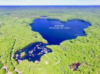 A great parcel to build your dream home on Alva Lake! The property features a cleared building site that is ready to be built. The home that was previously located on this location has been hauled away, so now is ready for a fresh start. There is 186' of water frontage and great views on just over 1 acre. Come take a look!