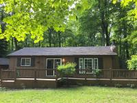 HIGHLAND DRIVE/ANVIL LAKE ACCESS HOME-This lovely year-round home is tucked on a wooded lot adjoining the Chequamegon-Nicolet National Forest and offers deeded access to crystal clear Anvil Lake! That of course means you have all the beautiful Northwoods of Wisconsin has to offer right at your fingertips! The home offers a flowing floor plan with a bright cheery kitchen and updated appliances, an authentic brick, wood burning fireplace, Pergo wood-look flooring, and a full bath with ceramic flooring and granite countertop. There's a full basement, a spacious cedar deck, nice landscaping, a garden shed and a covered wood rack. The 2-car garage rounds out this wonderful offering. What a great place to vacation or live, call today!