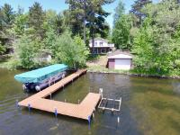 Beautiful Bearskin Lake property featuring 5 BR, 3 BTH with walkout basement and 100' of Level Sand frontage! This low maintenance home is perfect for a family getaway and can sleep a large crowd. In addition, there are 2 fireplaces both offering gas log on each level. The basement fireplace has a vacation mode thermostat for a backup heat source and the upper lakeside deck overlooking the water. The walkout basement patio has a built-in LP line for your grill and lends a level slope to the cute 18x22 ft boathouse with a rail system for your fishing trips. Bearskin Lake is 403 acres and is a class A Musky Lake and has a healthy population of walleye and other game fish. The home is just under 3,000 sqft with reclaimed charm for the original 1900's cabin that sat on the property. Do not miss this opportunity! Come see it today.