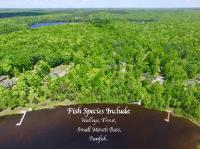 SPECTACLE LAKE LOT- A perfect place to make your Northwoods getaway. At just over 2 nicely wooded acres the lot is level to the water and has a sandy shoreline with 150' of frontage. Spectacle Lake is 166 acres with a depth of 35' and has a great population of game fish including, Trout, Walleye, Small Mouth Bass, Largemouth Bass, and Panfish. See great sunsets from the clear sandy frontage. There are ATV trails nearby as well and easy access to snowmobile and cross country ski trails nearby! The lot has a 24'x24' garage on a concrete slab that has electricity. The building site is ready to go and already has two holding tanks in the ground. Your cozy cabin getaway is almost ready!