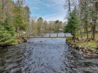 SEE TO BELIEVE this 67-acre estate w/5700'+ of frontage on Rice & Echo Lakes plus the Turtle River. Surrounded by water on 3 sides, there's a ready-to-use 1br/1ba guest cottage, a full log main home which could be the bones of a remarkable restoration project, miscellaneous structures, & an enchanting footbridge to the lot across the river with room to build a garage or repair the old one already there. Roam the trails, listen to the river's rapids & contemplate the possibilities: development property, subdivision, resort, hunting/fishing camp, or the ultimate family compound for vacations or full time living! Park at the lot across the river on Echo Lake road & walk the footbridge to the property or access through the long, winding gated driveway through the back 60 acres. Family is super motivated to sell--this property is offered at just a fraction of the original $1.69M list price! They are looking for offers!