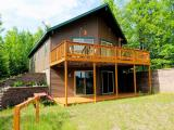 Purchase your own private paradise on a point with 1500 ft of shore line. This newer chalet style home with a walk out lower level sits on nearly five acres. The lower level is partially finished and could easily be completed. Cruise the 400 acre lake in the 2009 pontoon boat that is included. The main floor has an open floor plan with patio doors leading to the deck with great views of the lake. You can fish, water ski or sit on the deck & read a good book. This four season home would be a great place to come for snowmobiling or ice fishing in the winter. Located in Oconto County it is a short drive from the Fox Valley area.