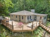 You will enjoy the stunning views of Wheeler Lake from your sun room or open deck. Wheeler Lake with its crystal clear water is one of the best lakes in the area. The open living area features a cozy fireplace. The four season room gives you great views of the lake. Enjoy outdoor living and cook outs on the spacious deck. The brick surface around the fire pit is a great area for the whole family to cozy up to & make those lasting memories. The well landscaped yard has beautiful perennials. A full basement provides a half bath & plenty of storage. This location is a short drive to golf, grocery store & churches. You should take a look at this four season home which has one of the nicest locations on the lake.