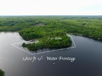 Wildcat Lake Lot! One of the most private lots on the lake with over 1,800ft of sand/rock water frontage and 7.36+/- acres. This incredible spot offers old growth timber featuring white pines, maple, oak and different species of spruce trees! The lot also offers multiple building sites with power at the road. This could be a cozy cabin location or a family compound property, skis the limit! There is even a spot out on the point that would make a great location for a screened gazebo. The southern view from this property looks out to a state-owned island that offers a true up north atmosphere. Wildcat Lake is 292 acres and 35 ft deep with a connecting lake of Big Kitten at 50 acres and 22ft deep. These lakes have a healthy population of walleye, musky, northern pike, bass and panfish. These lakes have a large about of state land and a very wilderness like environment. Don't miss this opportunity to see this property today.