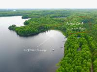 Wildcat Lake Lot! Here is an opportunity to own an affordable lot on one of Vilas county primer lakes! This lot is 14.3 +/-acres with 227 feet of southeast facing frontage. This lot is heavily wooded with old growth timber such as white pine, maple, oak and different species of spruce trees. The elevated lot offers incredible views of the lake with easy access off of wildcat rd. Wildcat Lake is 292 acres and 35 ft deep with a connecting lake of Big Kitten at 50 acres and 22ft deep. These lakes have a healthy population of walleye, musky, northern pike, bass and panfish. These lakes have a large about of state land and very wilderness like environment. Do not miss your opportunity to see this lot today!